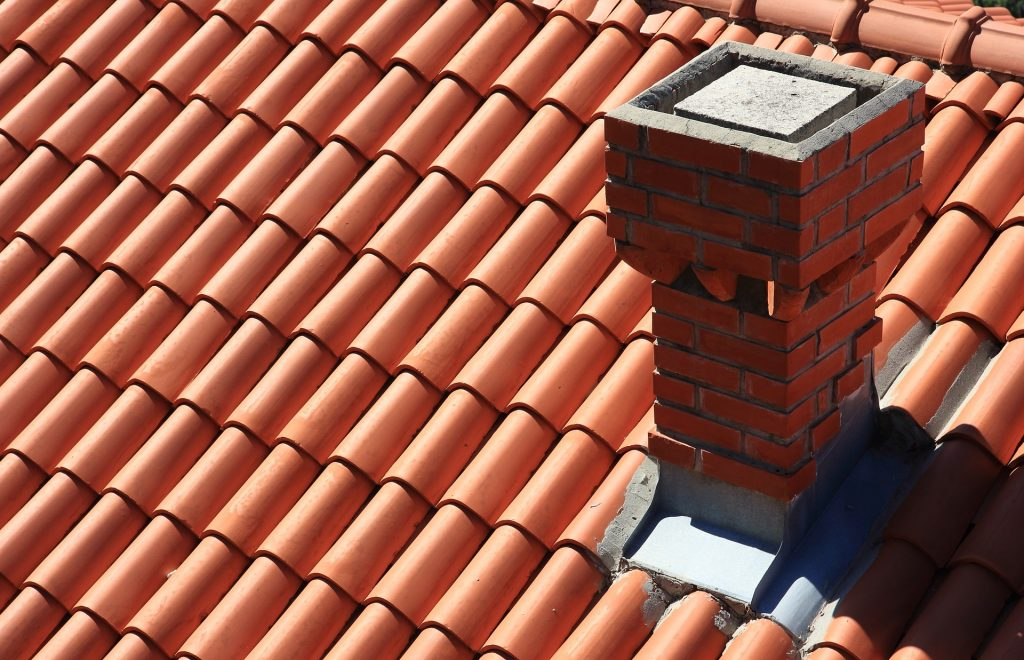 Repair cracks or damage around your chimney